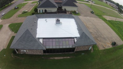 The flat section of this roof got sealed with our durable, long-lasting elastomeric coating system.
