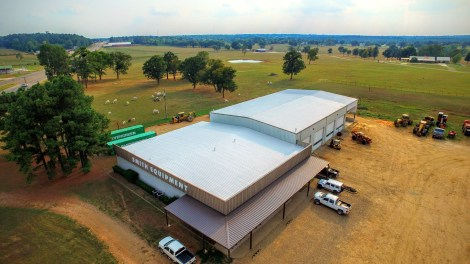 The lower, office area, of this this business has a foam and coatings system. The taller, shop area, has an MR system. (Metal Roof Restoration)